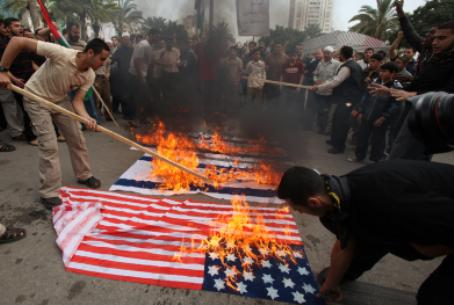 Hamas supporters burn Israeli and US flags