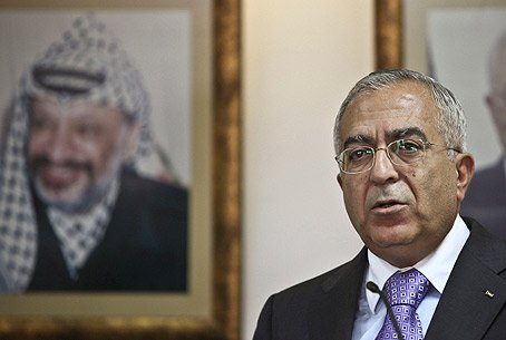 Fayyad, with Arafat on wall