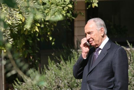 President Shimon Peres receives cell call