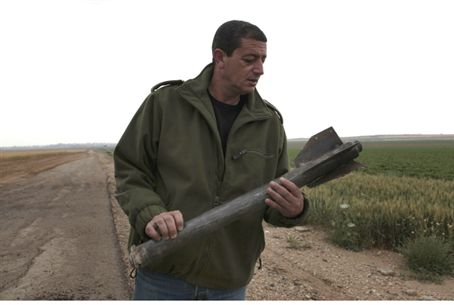 Sderot officer examines spent rocket