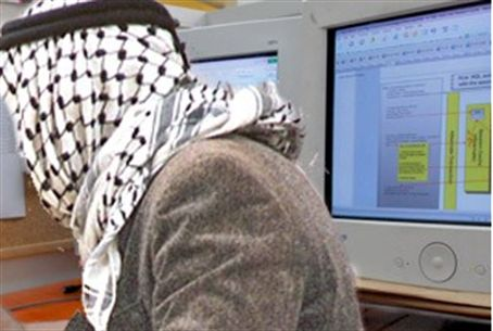 Arab in front of computer