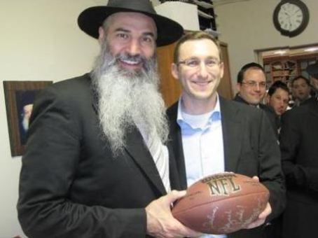 Veingrad at yeshiva, with an NFL football