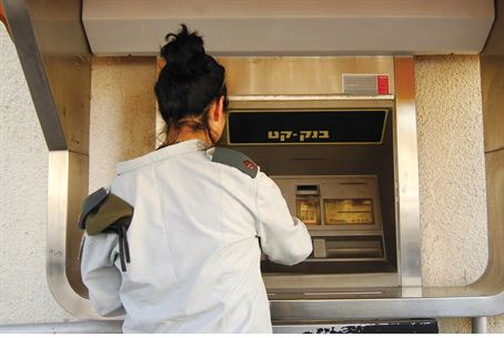IDF soldier at the ATM (illustrative)