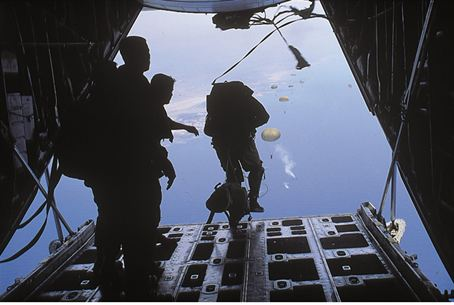 Paratroopers jump from an Israeli C-130J