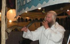 "blowing shofar at ""Kfar Tefillah"" tent"
