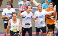 Barkat waves Israeli flag in race