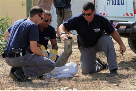 Security officials inspect Kassam in Ashkelon