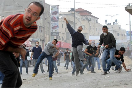 Arabs throw rocks in Qalandiya