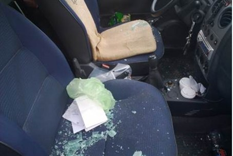 Shattered glass after rock-throwing terror