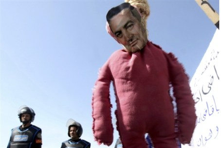 A protesters' effigy of Hosni Mubarak hangs o