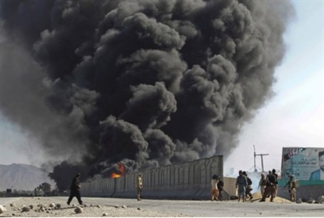 Afghani protesters set NATO fuel tank on fire