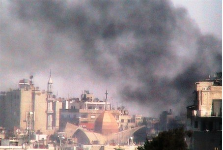 Smoke rises from Syrian shelling of Homs