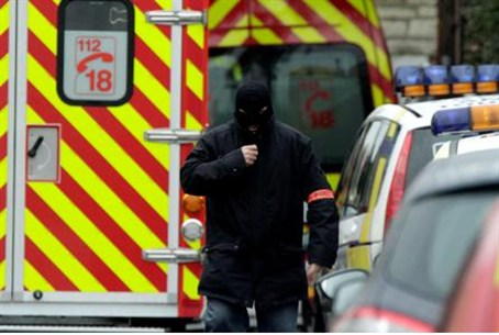 Masked French policeman at raid on terrorist'