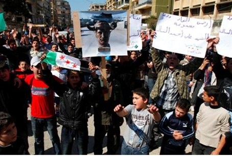 Lebanese and Syrian protesters shout slogans