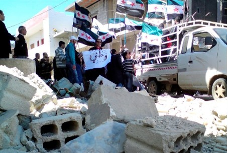 Syrians wave opposition flags at protest agai