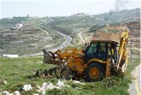 Tractor clears land for 'new' Migron