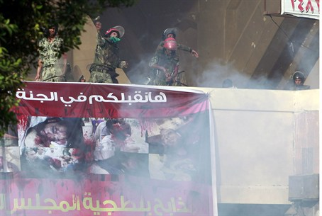 Security forces throw stones at protesters in