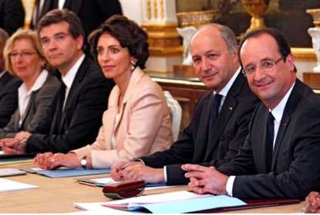 Hollande (R) seated with his newly appointed