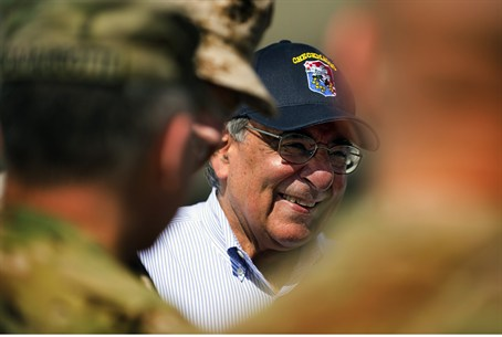 U.S. Defense Secretary Panetta smiles upon hi