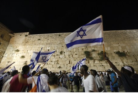 Waving Israeli flags in front of Kotel