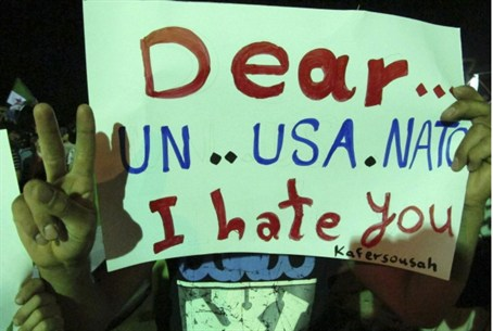 Sign at Syrian protest against Assad