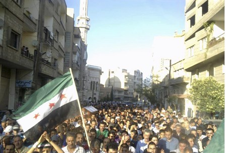 Opposition funeral in Damascus for boy killed