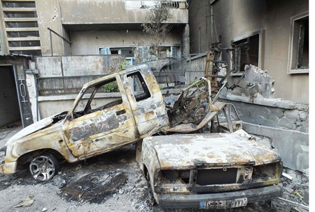 Vehicles destroyed by gov't shelling in Homs