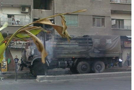 Assad forces truck burnt in rebel attack on D