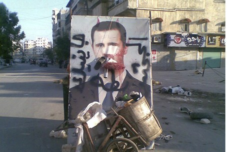 A defaced poster of Syria's President Bashar