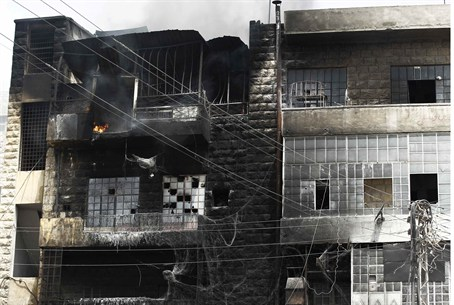 A building burns after shelling at Aleppo