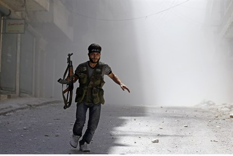 A Free Syrian Army fighter runs in Aleppo
