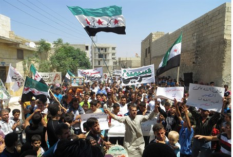 Demonstrators hold Syrian opposition flags du