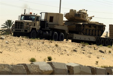 Egyptian army truck carries tanks and vehicle