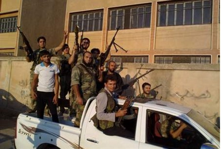 Free Syrian Army fighters pose with their wea