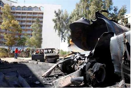 Burnt vehicles are seen after a bomb exploded