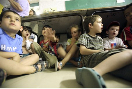 Children in bomb shelter (illustrative)