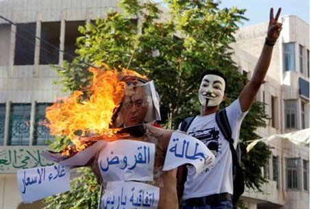 Arab protester wearing a Guy Fawkes mask ne