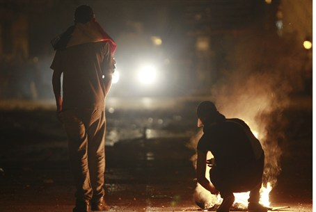 Cairo protester starting a fire