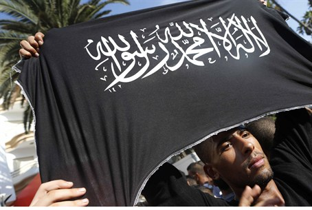 Protester holds Islamist flag at US Consulate