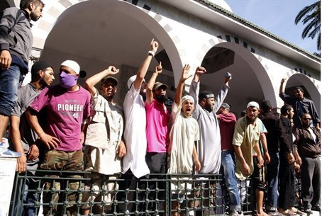 Tunisian Salafists shout slogans outside the