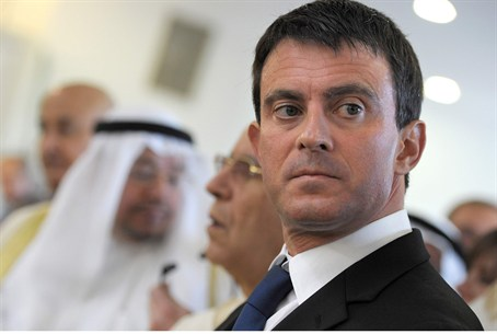 France's Interior Minister Valls stands on a
