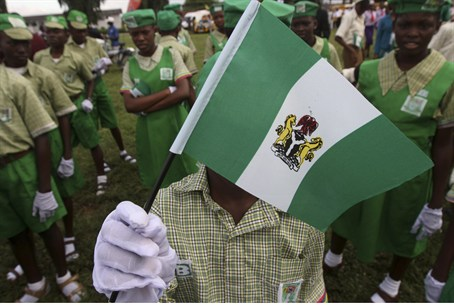 School children wait for the start of Nigeria