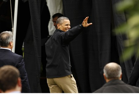 U.S. President Barack Obama waves as he depar