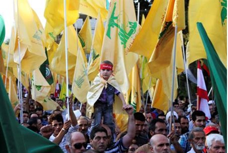 Supporters of Hizbullah leader Nasrallah wav
