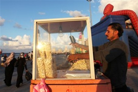 A man sells popcorn by the beach in Benghazi