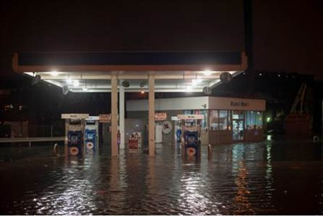 A gas station is submerged in floodwaters in