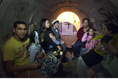 Residents of southern Israel in bomb shelter