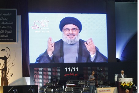 Sheikh Hassan Nasrallah on video link to a ra