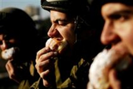 IDF soldiers munch on sufganiy