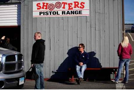 People wait to enter Shooters Pistol Range in